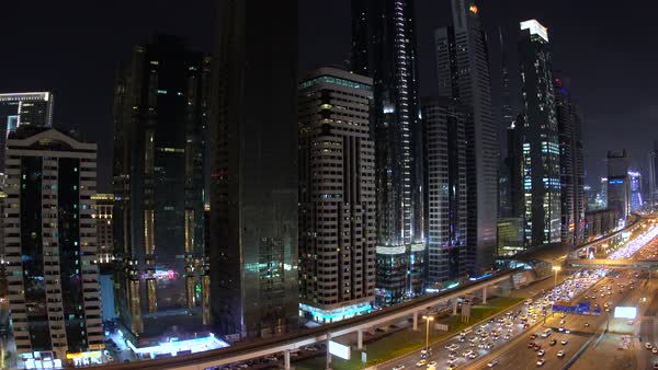 View down skyscrapers lining Sheikh Zayed Road at dusk, Dubai. Royalty-free stock video