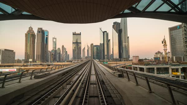 Time lapse of elevated metro train travelling along Sheikh Zayed road and downtown Dubai Royalty-free stock video