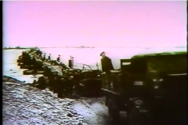 The allied troops continue to unload supplies on Normandy beach, and head north to Cherbourg, France in WWII, 1944. Royalty-free stock video