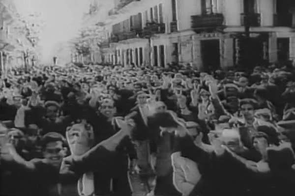 French, British and American troops and Tunisian citizens celebrate after the liberation of Tunis from Nazi occupation in WWII. Royalty-free stock video