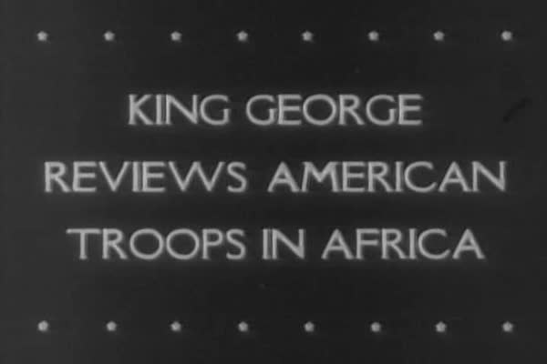 King George of Great Britain reviews American troops in North Africa during WWII. Royalty-free stock video