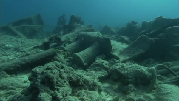 Divers from the US NOAA organization explore sunken shipwrecks and other wreckage from World War Two in the Pacific. Royalty-free stock video