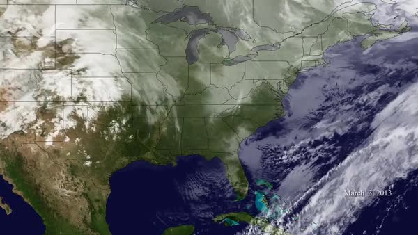 A weather map tracks a very large storm moving towards the East ...