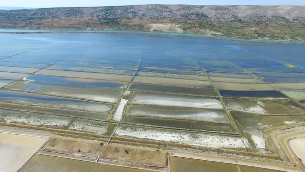 360 view of salt pans surrounded by sea and mountains, Pag island, Croatia Royalty-free stock video