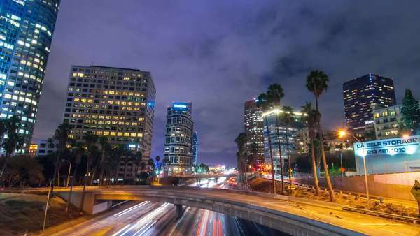 DOWNTOWN, LOS ANGELES, CALIFORNIA, USA - 15 OCTOBER 2014, Hyperlapse (timelapse in motion) video view on big city freeway traffic and dramatic clouds. Royalty-free stock video