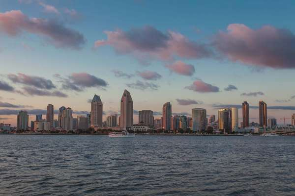 Hyperlapse of downtown San Diego with water in foreground Rights-managed stock video