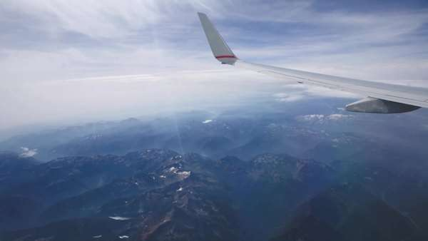 View of mountains and wingtip from airplane window Royalty-free stock video
