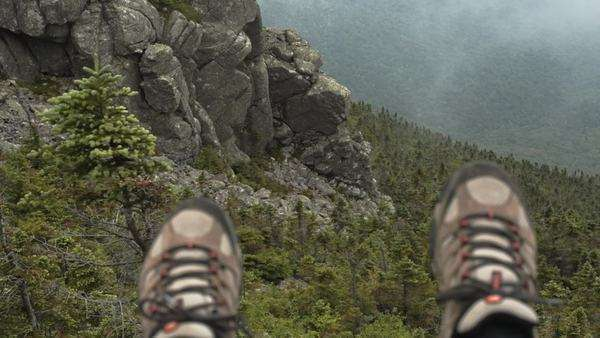 Hanging feet over edge of mountain Royalty-free stock video