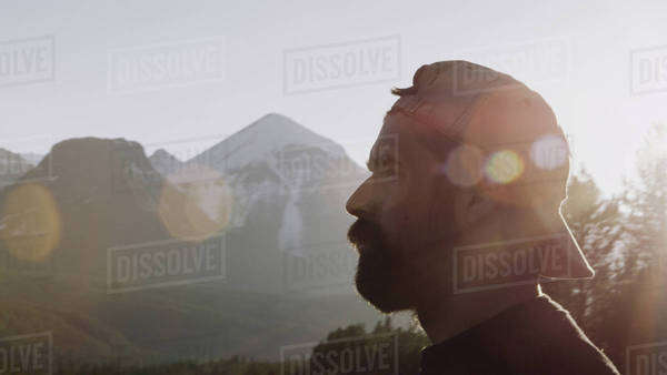 Man in front of mountains with lens flare Royalty-free stock photo