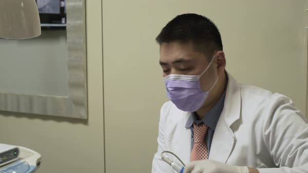 Zooming shot of a dentist at work Royalty-free stock video