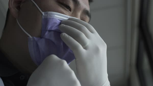 Low-angle shot of a doctor putting on a mask Royalty-free stock video
