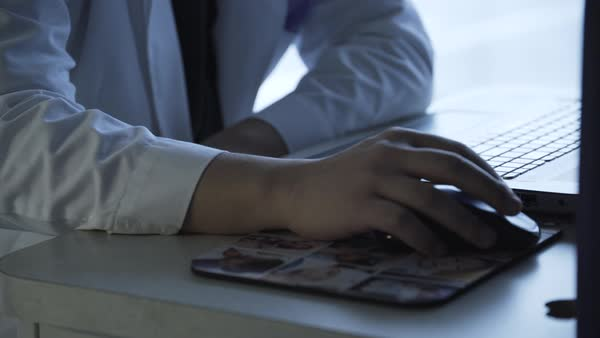 Hand-held shot of a doctor using a laptop Royalty-free stock video