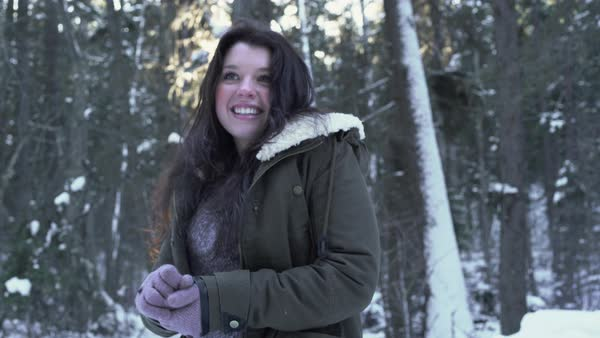 Camera tilt of a young woman in a winter forest Royalty-free stock video