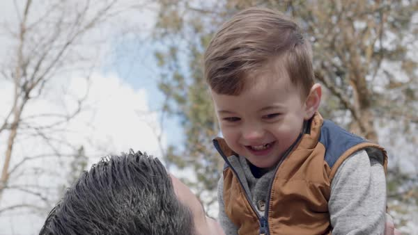 Slow motion shot of a father hugging his little boy Royalty-free stock video
