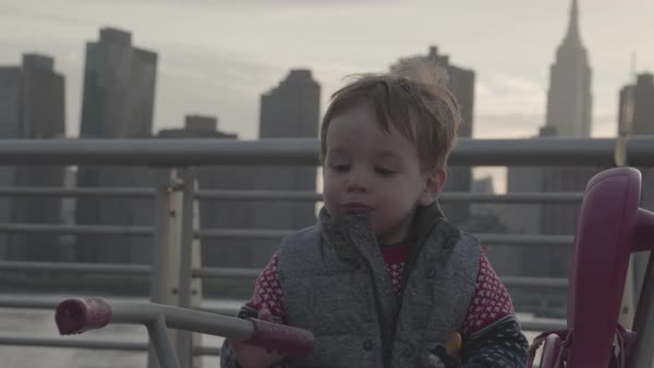 Hand-held shot of a toddler in New York by East River Royalty-free stock video