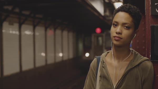 Slow motion shot of a woman on a subway platform looking at camera Royalty-free stock video