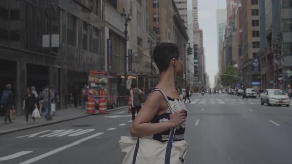 Point-of-view shot of a woman crossing a city street Royalty-free stock video