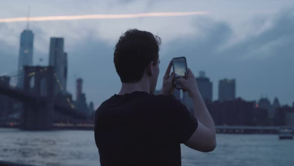 Hand-held shot of a young man taking photos of New York Royalty-free stock video