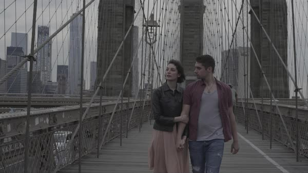 Front view shot of a couple walking on Brooklyn Bridge Royalty-free stock video