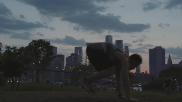Man doing burpees outside in the evening Royalty-free stock video