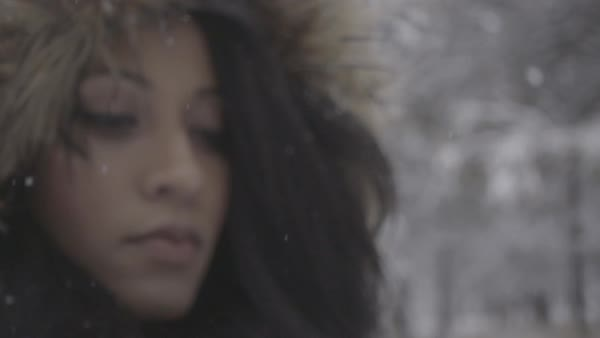 Close-up shot of a young woman wearing fur trim hood during the snowfall, Washington, United States of America Royalty-free stock video