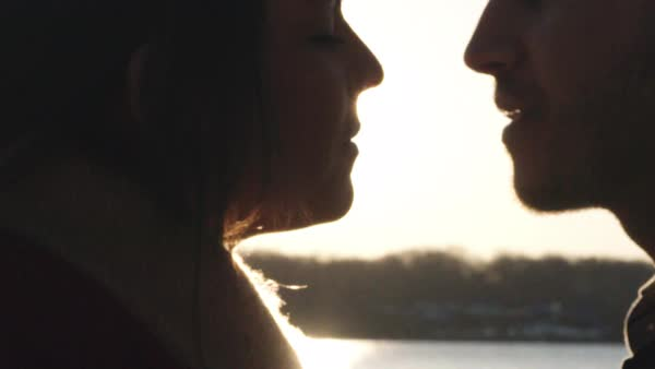 Close up shot of a couple kissing at sunset Royalty-free stock video