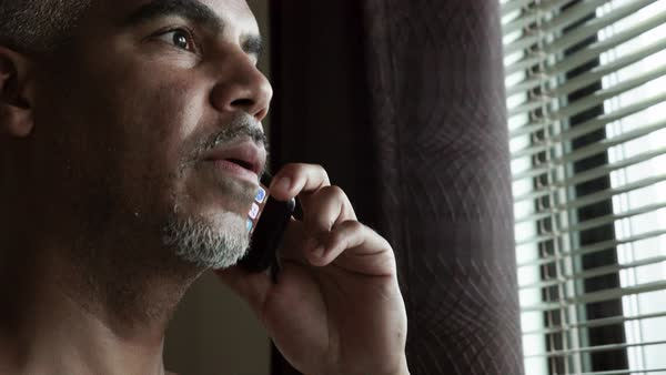Close-up shot of a man talking on his mobile phone Royalty-free stock video