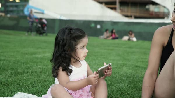 Hand-held shot of a toddler using a cell phone Royalty-free stock video