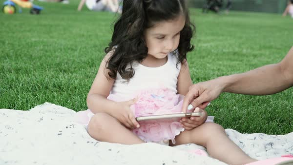 Hand-held shot of a mother and her daughter using a smartphone Royalty-free stock video