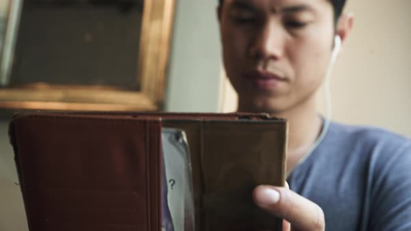 Medium close-up shot of a man holding a folder Royalty-free stock video