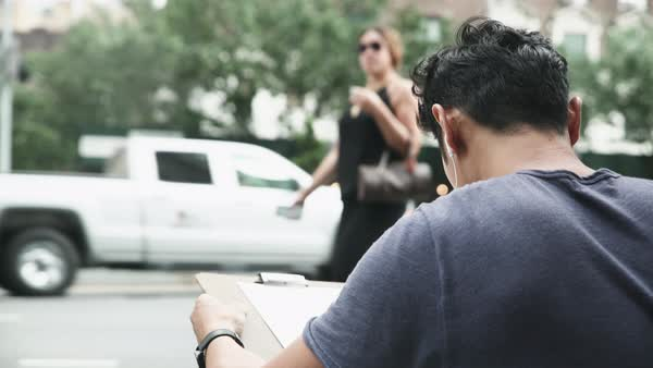Medium shot of a man drawing on a street Royalty-free stock video