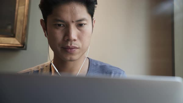 Medium close-up shot of a man working on his laptop Royalty-free stock video