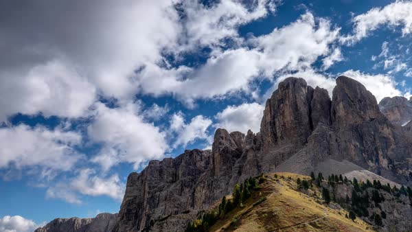 Timelapse of clouds moving above rocky peaks of Alps in Italy Royalty-free stock video