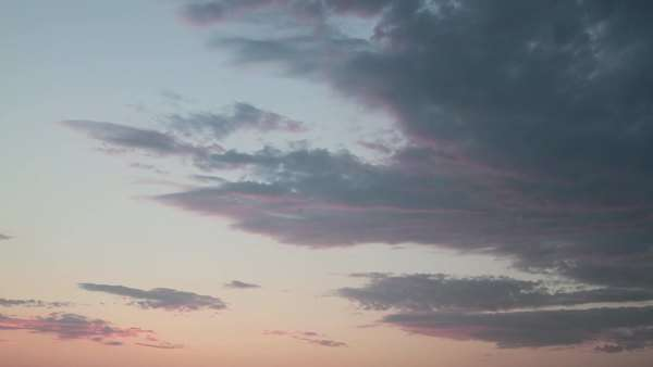 Pink and cloudy timelapse focusing on just the sky. Royalty-free stock video