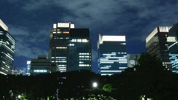 Timelapse - Tokyo Business District at Night with Clouds - Japan Royalty-free stock video