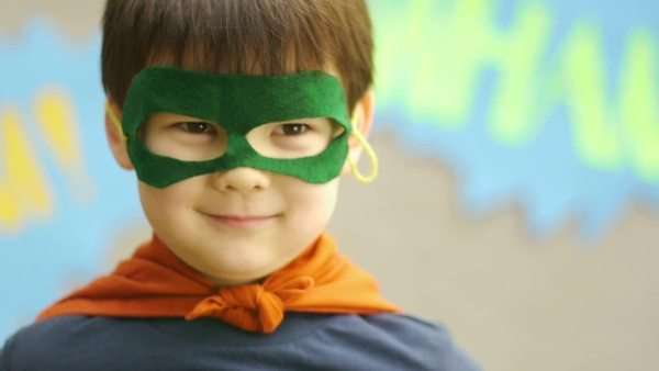 Superhero boy smiles and jumps Royalty-free stock video