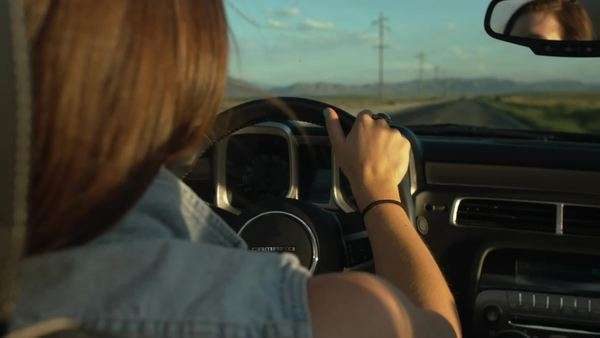 Pretty Teenage Girl Drives A Convertible In The Desert, Raises Hand (Rear View) Royalty-free stock video