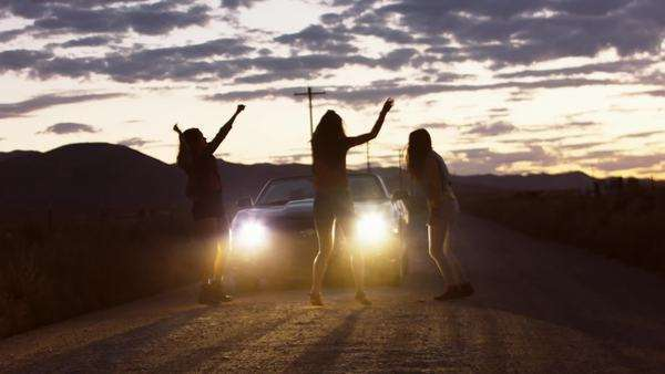 Three Teen Girls Dancing In Car Headlights On A Remote Dirt Road At Dusk Royalty-free stock video