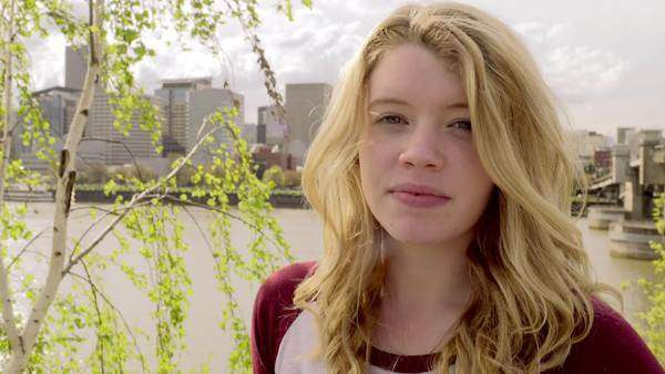 Portrait of young woman smiling, beautiful city view in background Royalty-free stock video