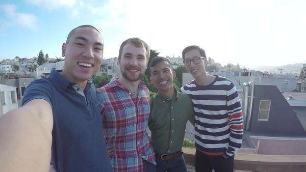 Asian man takes a selfie with a group of friends on a rooftop in San Francisco Royalty-free stock video