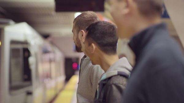 Two gay couples chat while they wait for their subway train to pull up to platform Royalty-free stock video