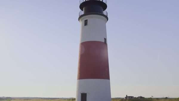 Establishing shot of sankaty head lighthouse on nantucket island, massachusetts Royalty-free stock video