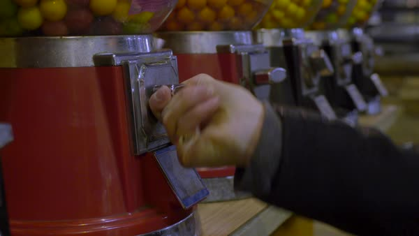 Close-up of teen's hand as she pays for a gumball Royalty-free stock video