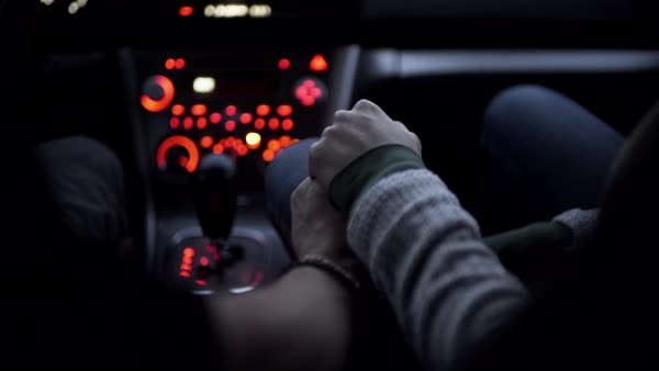 Male driver and female passenger hold hands in moving car Royalty-free stock video