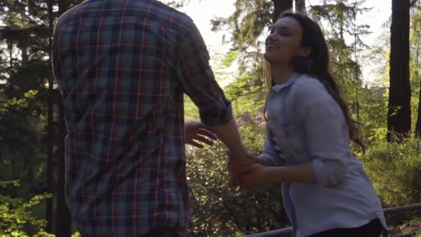 Young Woman Holds Her Boyfriends Hand, Coaxes Him Into A Run, In Park At Sunset (Slow Motion Steadicam Shot) Royalty-free stock video