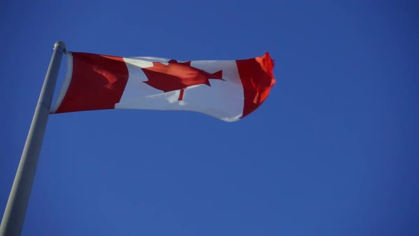 Slow motion of Canada flag used fluttering in the wind against blue sky Royalty-free stock video