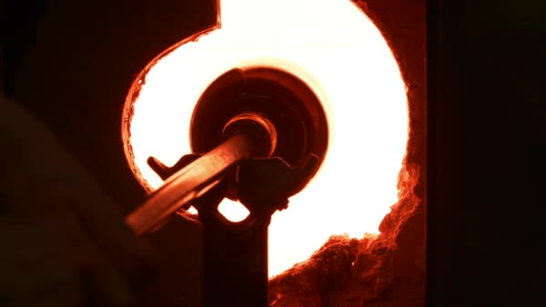 Blowing glass - heating the piece in the glory hole Royalty-free stock video