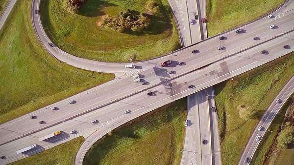 Aerial Footage of Highway and Overpass Urban Life with cars and trucks Royalty-free stock video