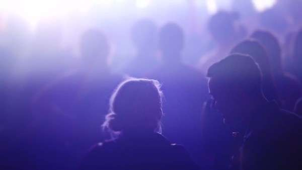 Couple talking together during a music performance Royalty-free stock video