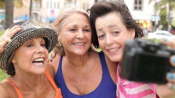 Group of three senior women posing for selfie photograph in park. Royalty-free stock video